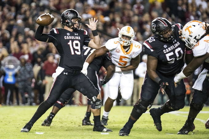 South Carolina quarterback Jake Bentley (19) attempts a pass against Tennessee during the first half of an NCAA college football game Saturday, Oct. 27, 2018, in Columbia, S.C. South Carolina defeated Tennessee 27-24. (AP Photo/Sean Rayford)