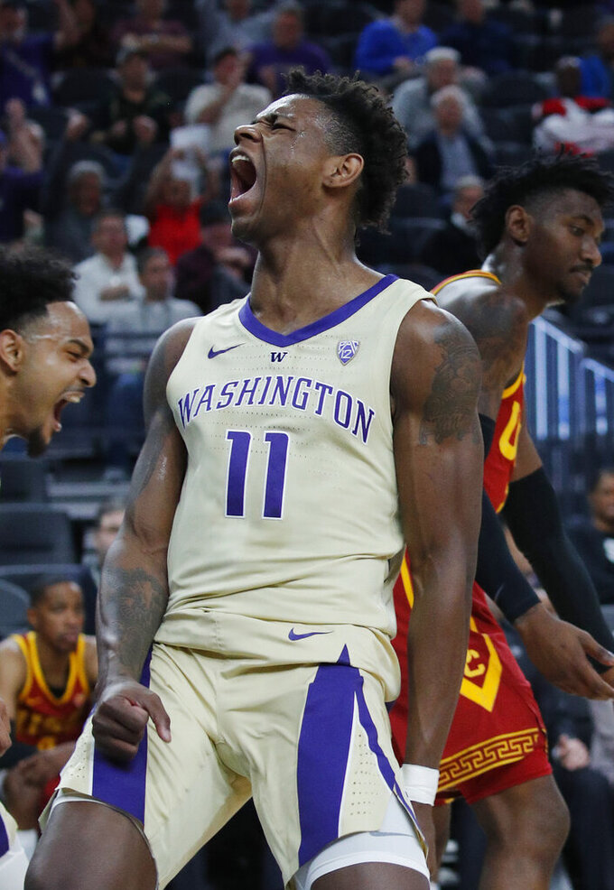 Washington's Nahziah Carter celebrates after scoring against Southern California during the first half of an NCAA college basketball game in the quarterfinal round of the Pac-12 men's tournament Thursday, March 14, 2019, in Las Vegas. (AP Photo/John Locher)