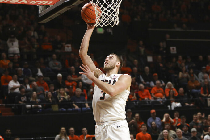 Oregon State's Tres Tinkle (3) scores during the first half of an NCAA college basketball game against Southern California in Corvallis, Ore., Saturday, Jan. 25, 2020. (AP Photo/Amanda Loman)