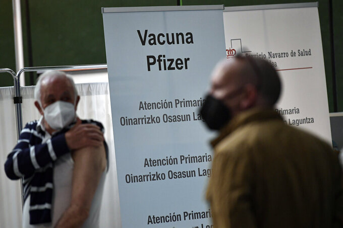 Jesus Garcia Beitia, 76, left, wait to receives a shot of Pfizer vaccine during a COVID-19 vaccination campaign, in Pamplona, northern Spain, Friday, May 7, 2021.(AP Photo/Alvaro Barrientos)