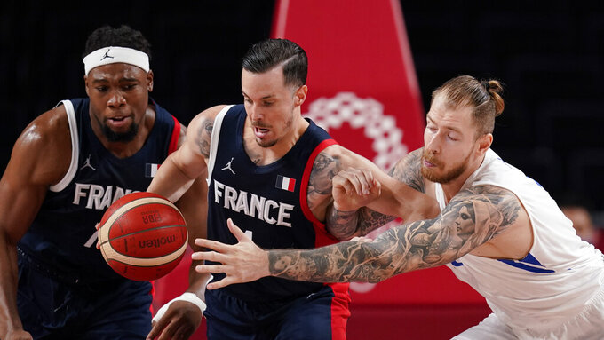 France's Thomas Heurtel, center, steals the ball from Czech Republic's Patrik Auda, right, as Guerschon Yabusele, left, looks on during a men's basketball preliminary round game at the 2020 Summer Olympics in Saitama, Japan, Wednesday, July 28, 2021. (AP Photo/Charlie Neibergall)