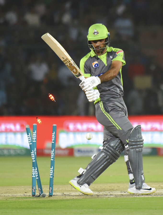 Lahore Qalandars opening batsman Fakhar Zaman is clean bowled during a Pakistan Super League match against Karachi Kings at the National Stadium, Thursday, March 12, 2020. (AP Photo/Fareed Khan)