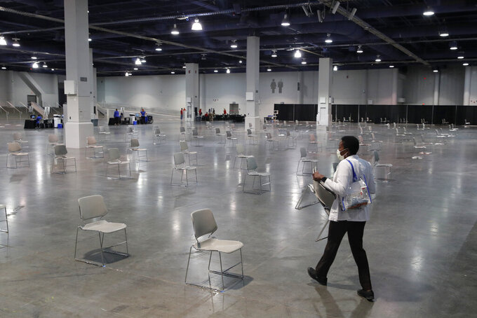 FILE - In this May 21, 2020 file photo chairs are spaced out for social distancing at a temporary coronavirus testing facility at the Las Vegas Convention Center, in Las Vegas. Health officials in Las Vegas say they hope to administer more than 1,000 doses of coronavirus vaccine a day to area residents once a big drive-thru COVID-19 shot clinic opens Tuesday, May 4, 2021 at the Las Vegas Convention Center. (AP Photo/John Locher,File)