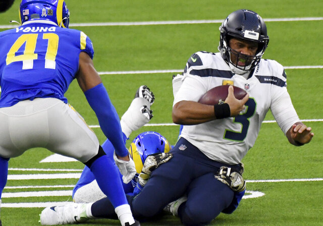 Seattle Seahawks quarterback Russell Wilson (3) scrambles against the Los Angeles Rams in the fourth quarter of an NFL football game in Inglewood, Calif., Sunday, Nov. 15, 2020. (Keith Birmingham/The Orange County Register via AP)
