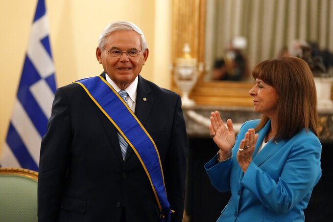 Greek President Katerina Sakellaropoulou, right, applauds US Senator Bob Menendez, chairman of the Senate Foreign Relations Committee after she awarded him with the Grand Cross of the Order of the Redeemer at the Presidential Palace in Athens, Friday, Aug. 27, 2021. Menendez on his two-day trip in Greece, discussed with top Greek officials the strategic relationship between Greece and the US as well as developments in the eastern Mediterranean and the Middle East. (AP Photo/Thanassis Stavrakis)