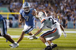 North Carolina quarterback Sam Howell (7) runs against Virginia free safety Joey Blount (29) during the second half of an NCAA college football game in Chapel Hill, N.C., Saturday, Sept. 18, 2021. (AP Photo/Gerry Broome)