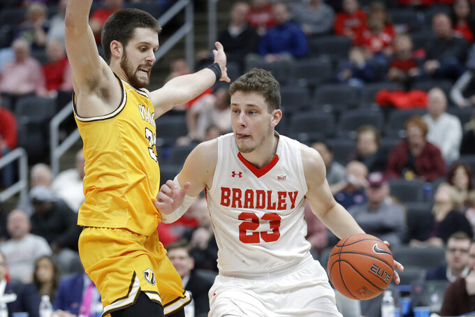 Bradley's Ville Tahvanainen, right, drives around Valparaiso's John Kiser during the first half of an NCAA college basketball game in the championship of the Missouri Valley Conference men's tournament Sunday, March 8, 2020, in St. Louis. (AP Photo/Jeff Roberson)