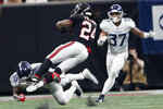 Tennessee Titans inside linebacker Jayon Brown (55) hits Atlanta Falcons running back Devonta Freeman (24) during the second half of an NFL football game, Sunday, Sept. 29, 2019, in Atlanta. The Tennessee Titans won 24-10. (AP Photo/John Bazemore)