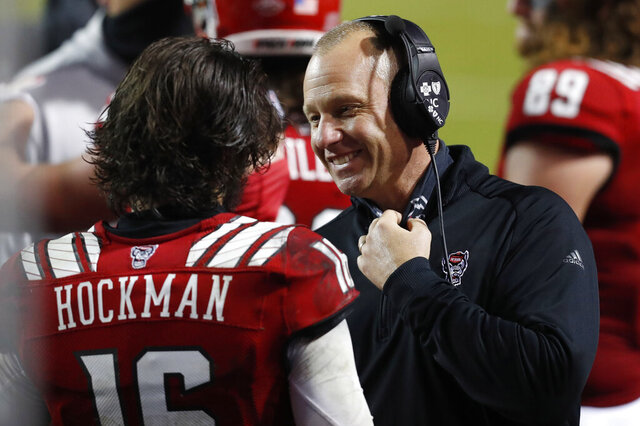 North Carolina State coach Dave Doeren talks with quarterback Bailey Hockman (16) during the second half against Liberty in an NCAA college football game Saturday, Nov. 21, 2020, in Raleigh, N.C. (Ethan Hyman/The News & Observer via AP, Pool)