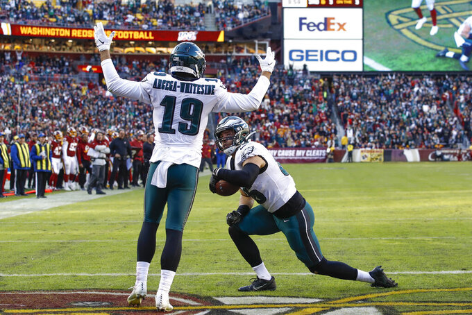 Philadelphia Eagles tight end Zach Ertz (86) is greeted in the end zone by teammate wide receiver J.J. Arcega-Whiteside (19) after scoring a touchdown in the second half of an NFL football game, Sunday, Dec. 15, 2019, in Landover, Md. (AP Photo/Patrick Semansky)