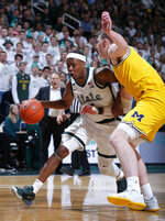 Michigan State's Cassius Winston, left, drives against Michigan's Jon Teske during the second half of an NCAA college basketball game, Sunday, Jan. 5, 2020, in East Lansing, Mich. (AP Photo/Al Goldis)