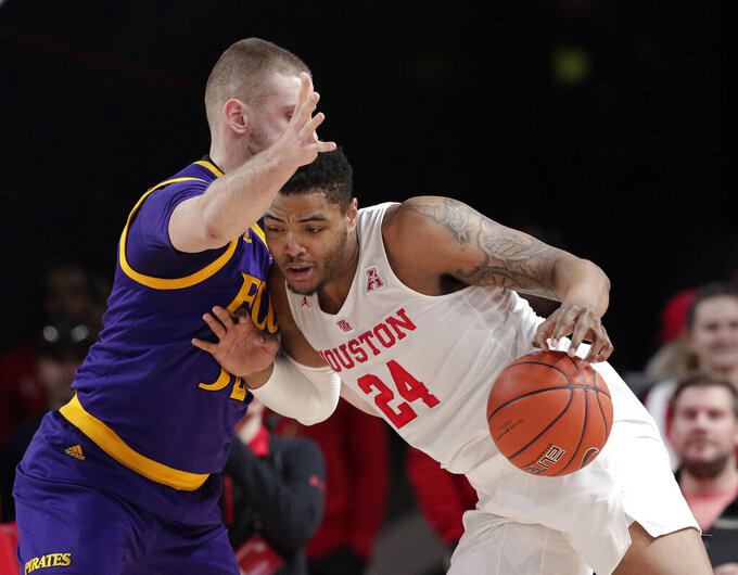 Houston forward Breaon Brady (24) drives against East Carolina forward Dimitrije Spasojevic during the first half of an NCAA college basketball game Wednesday, Jan. 23, 2019, in Houston. (AP Photo/Michael Wyke)