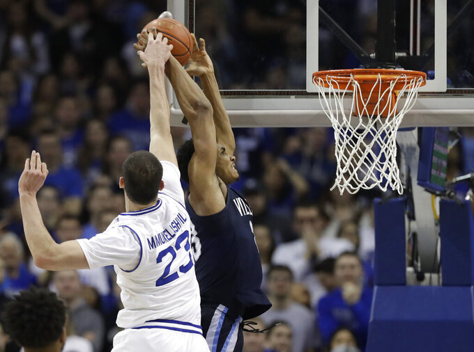 Seton Hall forward Sandro Mamukelashvili (23) dislodges the ball from Villanova forward Jermaine Samuels (23) during the second half of an NCAA college basketball game, Saturday, March 9, 2019, in Newark, N.J. Seton Hall defeated Villanova 79-75. (AP Photo/Kathy Willens)