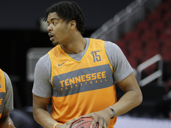 FILE - This March 27, 2019 file photo shows Tennessee's Derrick Walker (15) during practice for the NCAA men's college basketball tournament in Louisville, Ky.  The NCAA has suspended Walker for the first 16 games of the season for a rules violation while he was at Tennessee in 2018-19. The Nebraska athletic department made the announcement Wednesday, Nov. 25, 2020,  shortly before the Cornhuskers' opener against McNeese State.(AP Photo/Michael Conroy)