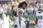 FILE - In this Oct. 13, 2019, file photo New York Jets' Leonard Williams warms-up before an NFL football game against the Dallas Cowboys in East Rutherford, N.J. A person with direct knowledge of the deal says the New York Jets have traded Williams to the Giants for a third-round draft pick next year and a fifth-rounder in 2021. (AP Photo/Adam Hunger, File)
