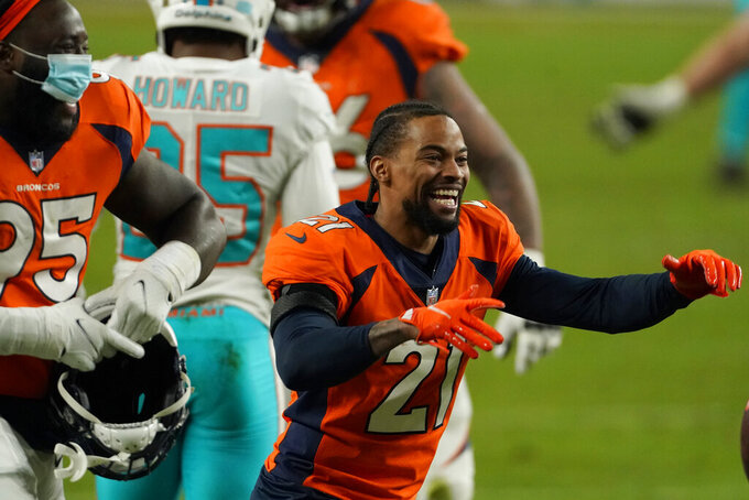 Denver Broncos cornerback A.J. Bouye (21) celebrates after an NFL football game against the Miami Dolphins, Sunday, Nov. 22, 2020, in Denver. The Broncos won 20-13. (AP Photo/Jack Dempsey)