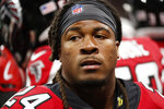 FILE - In this Aug. 15, 2019, file photo, Atlanta Falcons running back Devonta Freeman (24) sits on the bench during the first half an NFL preseason football game against the New York Jets, in Atlanta. The Atlanta Falcons will dramatically boost their financial flexibility by releasing three high-priced veterans _ running back Devonta Freeman, cornerback Desmond Trufant and offensive tackle Ty Sambrailo. The Falcons announced the Sambrailo move on Monday, March 16, 2020. The team is finalizing the moves with Freeman and Trufant, former Pro Bowl players who had been considered foundation players for the franchise. Financial constraints made the moves necessary.The cuts will clear $12.15 million in salary cap space before Wednesday's start of free agency. (AP Photo/John Bazemore, File)