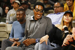 Former Chicago Bulls star Scottie Pippen watches during the second half of an NCAA college basketball game between Vanderbilt and Southeast Missouri State Wednesday, Nov. 6, 2019, in Nashville, Tenn. Pippen's son, Scotty Pippen Jr., plays for Vanderbilt. (AP Photo/Mark Humphrey)