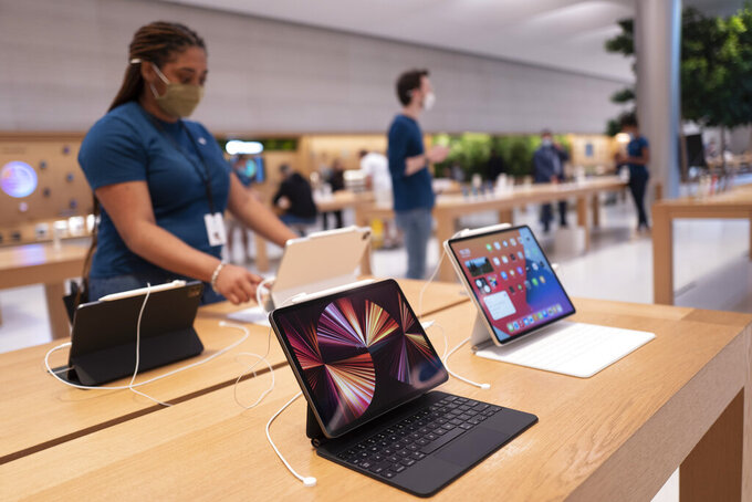 New iPad Pros are displayed at an Apple Store, Friday, May 21, 2021, in New York. The latest iPad Pros will work on ultrafast 5G wireless networks.  Technology company stocks are in rest mode this year, but what may seem like weakness as the economy recovers is really just dormancy. Digital devices, software and even cybersecurity will be the key areas for steady growth as consumers and businesses become more digital in how they operate, analysts say.   (AP Photo/Mark Lennihan)