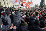 CAPTION CORRECTS PRO GOVERNMENT PEOPLE TO PLAIN CLOTHED POLICE Protesters argue with plain clothed police, during a rally in downtown Minsk, Belarus, Saturday, Dec. 7, 2019. Several hundreds demonstrators gathered to protest against closer integration with Russia. (AP Photo/Sergei Grits)