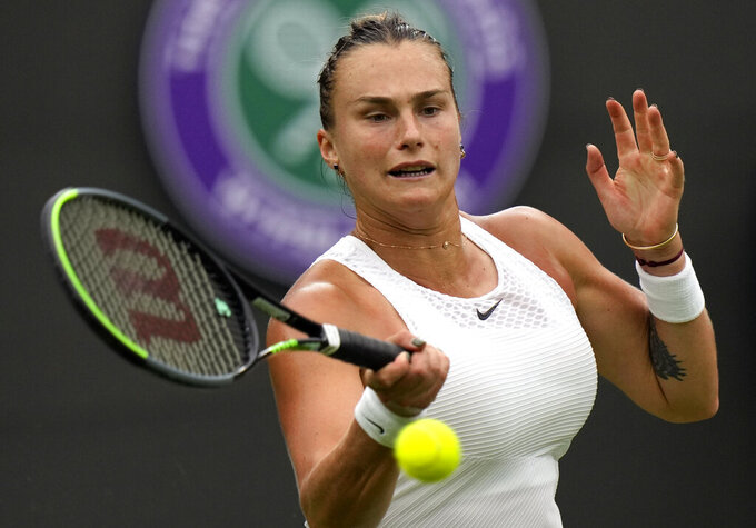 Belarus's Aryna Sabalenka returns the ball to Romania's Monica Niculescu during their first round women's singles match on day one of the Wimbledon Tennis Championships in London, Monday June 28, 2021. (AP Photo/Alastair Grant)