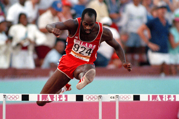 FILE - In this Aug. 5, 1984, file photo, United States' Edwin Moses jumps a hurdle on his way to winning the gold medal in the 400-meter hurdles at the Summer Olympic Games in Los Angeles. (AP Photo/File)