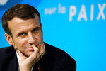 French President Emmanuel Macron attends the Paris Peace Forum, Tuesday, Nov. 12, 2019 in Paris. French President Emmanuel Macron is hosting an international peace forum _ in the notable absence of the United States _ to discuss solutions to ease the world's tensions, including fighting terrorism and climate change. (Ludovic Marin/Pool via AP)