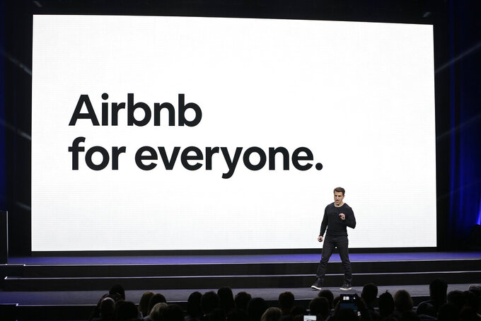 FILE - In this Feb. 22, 2018, file photo, Airbnb CEO Brian Chesky speaks during an event in San Francisco. Airbnb Inc. is being asked to drop its sponsorship connections to 2022 Beijing Winter Olympics by a coalition of 150 human-rights campaigners. The coalition is headed by groups that oppose rights violations in China including widely reported genocide against Muslim Uyghurs in the Xinjiang region. An open letter sent on Tuesday, March 23, 2021 to Chesky argues that Airbnb is trying to drive tourism in China at the expense of Uyghurs and Tibetans who cannot travel freely in the country. (AP Photo/Eric Risberg, File)