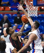 Boise State forward Zach Haney blocks a shot by UNLV guard Kris Clyburn during the first half of an NCAA college basketball game Wednesday, Feb. 6, 2019, in Boise, Idaho. (Darin Oswald/Idaho Statesman via AP)