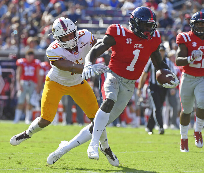 Mississippi wide receiver A.J. Brown (1) attempts to evade Louisiana Monroe safety Austin Hawley (15) during the first half of an NCAA college football game in Oxford, Miss., Saturday, Oct. 6, 2018. (AP Photo/Thomas Graning)