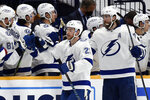 Tampa Bay Lightning center Brayden Point (21) is congratulated after scoring a goal against the Nashville Predators during the second period of an NHL hockey game Tuesday, April 13, 2021, in Nashville, Tenn. (AP Photo/Mark Zaleski)
