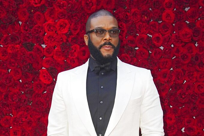 FILE - Tyler Perry poses at the grand opening of Tyler Perry Studios in Atlanta on Oct. 5, 2019.  Perry and the Motion Picture and Television Fund are being honored with the Jean Hersholt Humanitarian Award, the Academy of Motion Picture Arts and Sciences said Thursday. Perry and the MPTF will receive their Oscar statuettes at the 93rd Academy Awards on April 25.  (Photo by Elijah Nouvelage/Invision/AP, File)
