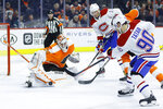 Philadelphia Flyers' Alex Lyon (34) cannot stop a goal by Montreal Canadiens' Tomas Tatar (90) during the first period of an NHL hockey game, Thursday, Jan. 16, 2020, in Philadelphia. (AP Photo/Matt Slocum)