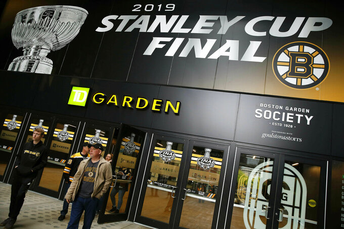 Fans enter the arena for Game 2 of the NHL hockey Stanley Cup Final between the St. Louis Blues and the Boston Bruins, Wednesday, May 29, 2019, in Boston. (AP Photo/Michael Dwyer)