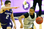 Chicago State guard Xavier Johnson, right, drives against Northwestern guard Ryan Greer during the first half of an NCAA college basketball game in Evanston, Ill., Saturday, Dec. 5, 2020. (AP Photo/Nam Y. Huh)