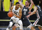 Colorado forward Dallas Walton, left, drives to the rim as Washington State forwards Jeff Pollard, center, and CJ Elleby defend in the first half of an NCAA college basketball game Thursday, Jan. 23, 2020, in Boulder, Colo. (AP Photo/David Zalubowski)