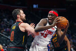 Detroit Pistons forward Sekou Doumbouya (45) is defended by Cleveland Cavaliers forward Kevin Love (0) during the first half of an NBA basketball game Thursday, Jan. 9, 2020, in Detroit. (AP Photo/Carlos Osorio)