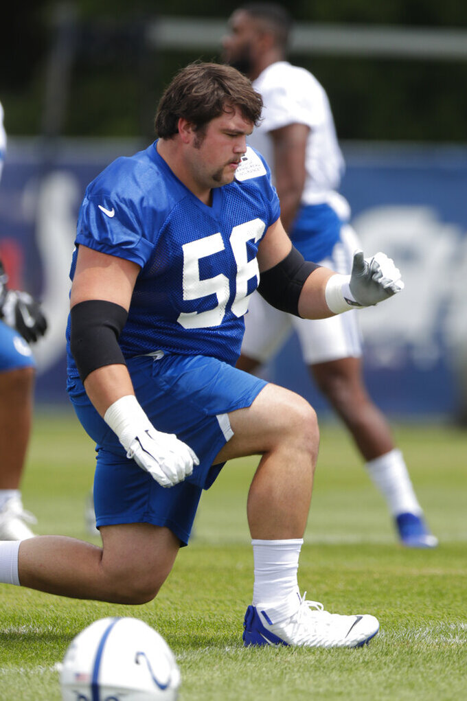 Indianapolis Colts offensive guard Quenton Nelson (56) warms up during practice at the NFL team's football training camp in Westfield, Ind., Friday, July 26, 2019. (AP Photo/Michael Conroy)