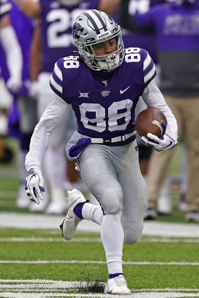 Kansas State wide receiver Phillip Brooks runs the ball to score a touchdown on a punt return during the first half of an NCAA football game against Kansas State Saturday, Oct. 24, 2020, in Manhattan, Kan. (AP Photo/Charlie Riedel)