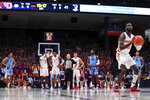 Dayton's Jalen Crutcher shoots a technical free throw during an NCAA college basketball game against Rhode Island, Tuesday, Feb. 11, 2020, in Dayton, Ohio. Dayton won 81-67. (AP Photo/Aaron Doster)
