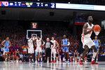 Dayton's Jalen Crutcher shoots a technical free throw during an NCAA college basketball game against Rhode Island, Tuesday, Feb. 11, 2020, in Dayton, Ohio. Dayton won 81-67. (AP Photo/Aaron Doster)