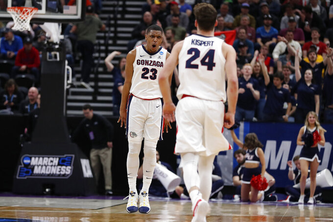 Gonzaga guard Zach Norvell Jr. (23) reacts after a 3-pointer by forward Corey Kispert (24) during the first half of a first-round game against Fairleigh Dicinson in the NCAA men's college basketball tournament Thursday, March 21, 2019, in Salt Lake City. (AP Photo/Jeff Swinger)