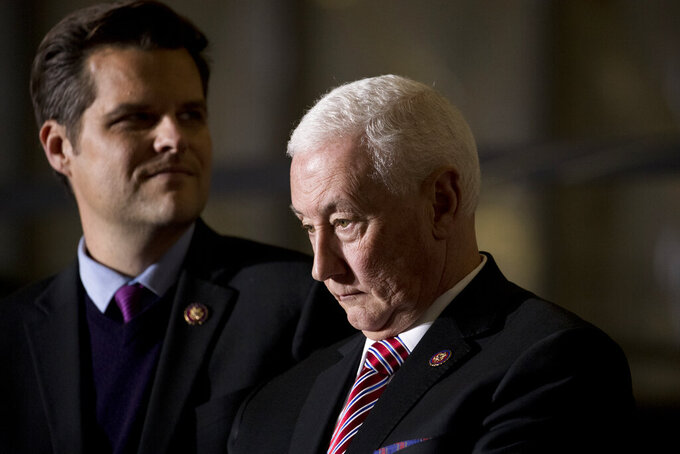 """FIL E- In this Dec. 20, 2019, file photo Rep. Matt Gaetz, R-Fla., left, and Rep. Greg Pence, R-Ind., right, arrive before President Donald Trump signs the National Defense Authorization Act for Fiscal Year 2020 at Andrews Air Force Base, Md. In one of the most chilling scenes from the Jan. 6 insurrection, a violent mob surged through the halls of the U.S. Capitol chanting """"hang Mike Pence."""" But when the House moved this week to create an independent commission to investigate the tragedy, the former vice president's brother voted no. (AP Photo/Andrew Harnik, File)"""