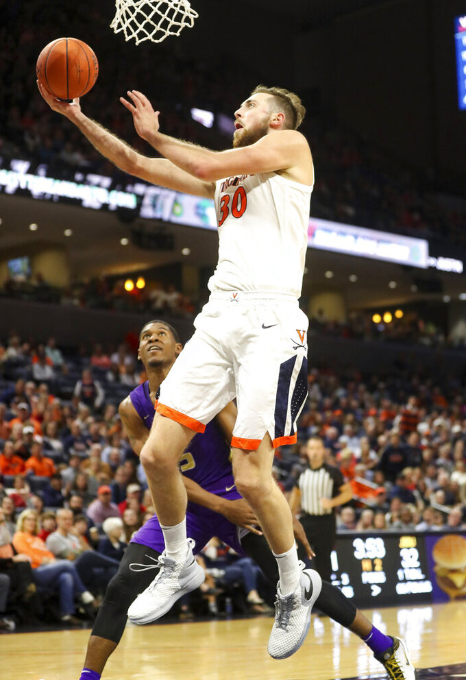 Virginia forward Jay Huff (30) shoots over James Madison guard Darius Banks (5) during an NCAA college basketball game in Charlottesville, Va., Sunday, Nov. 10, 2019. (AP Photo/Andrew Shurtleff)