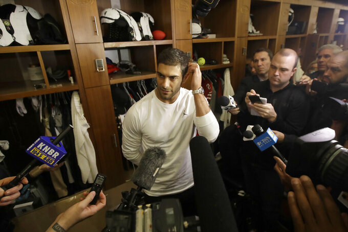 San Francisco 49ers quarterback Jimmy Garoppolo speaks to reporters at the team's NFL football training facility in Santa Clara, Calif., Wednesday, Feb. 5, 2020. (AP Photo/Jeff Chiu)