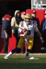 LSU quarterback Joe Burrow (9) scrambles in the first half of an NCAA college football game against Alabama, Saturday, Nov. 9, 2019, in Tuscaloosa, Ala. (AP Photo/John Bazemore)