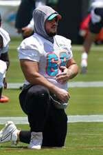 Miami Dolphins guard Durval Queiroz Neto stretches out during practice at the NFL football team's training facility, Friday, Aug. 6, 2021, in Miami Gardens, Fla. (AP Photo/Wilfredo Lee)