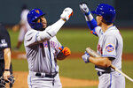 New York Mets' Dominic Smith, left, is congratulated by Brandon Nimmo after his three-run home run off Boston Red Sox relief pitcher Jeffrey Springs during the fourth inning of a baseball game Monday, July 27, 2020, at Fenway Park in Boston. (AP Photo/Charles Krupa)