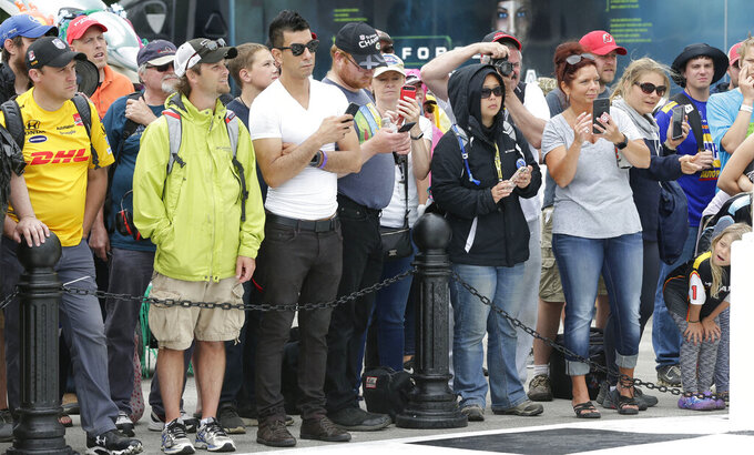 IndyCar fans wait near victory lane following the Rev Group Grand Prix IndyCar race , Sunday, June 23, 2019, at Road America in Elkhart Lake, Wis. The IndyCar series will welcome fans for the first time of the year during the REV Group Grand Prix doubleheader Saturday and Sunday, July 11-12, 2020, at Road America in Plymouth, Wisconsin. (Gary C. Klein/The Sheboygan Press via AP)