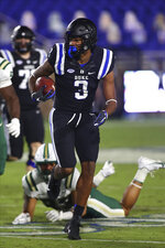 Duke wide receiver Jontavis Robertson (1) runs with the ball during the first quarter against Charlotte in an NCAA college football game Saturday, Oct. 31, 2020, in Durham, N.C. (Jaylynn Nash/Pool Photo via AP)
